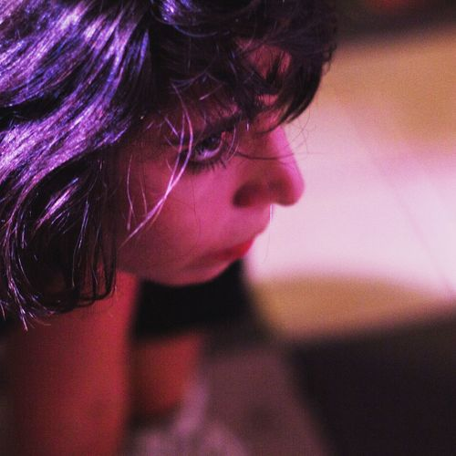Close-up portrait of girl with purple hair