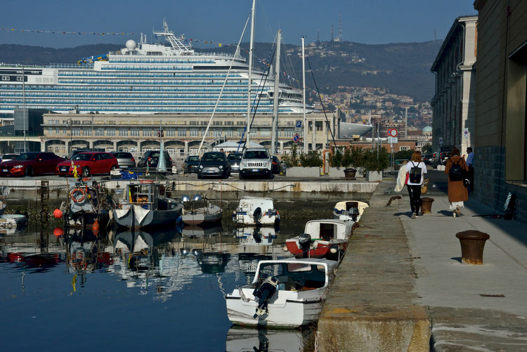 Trieste city harbor with Costa Venezia moored Trieste Costa Crociere Costa Venezia Mode Of Transportation Cruise Cruise Ship Lifestyles Real People Outdoors Transportation Nautical Vessel Building Exterior Eataly Harbor Sailboat Nature Architecture Reflection Pier Moored Sea Seascape Incidental People City Day