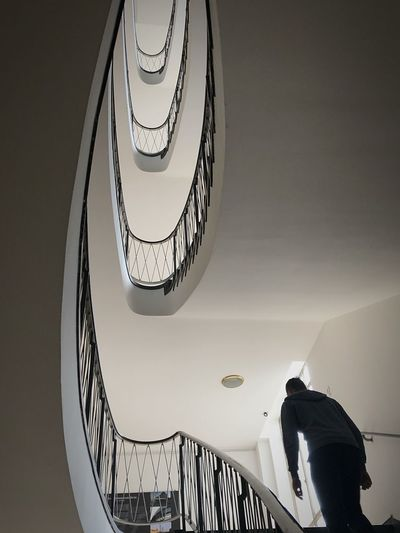 No People Low Angle View Architecture Indoors  Railing Built Structure Staircase Steps And Staircases