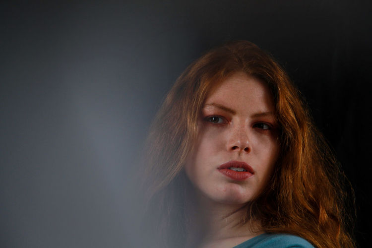 Portrait Headshot Studio Shot One Person Black Background Women Indoors  Young Adult Adult Sadness Redhead Emotion Beautiful Woman Copy Space Contemplation Looking At Camera Serious Beauty Hair Depression - Sadness Hairstyle Human Face Dyed Red Hair International Women's Day 2019 My Best Photo