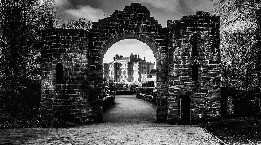 CulzeanCastle Through The Arch Blackandwhite Black & White Blackandwhite Photography Brickwork  Fortress Arch Trees National Trust Historical Building Architecture Historical Sights Sightseeing Taking Photos Light And Shadow Pathway