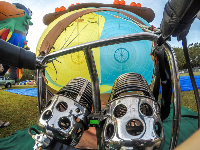 Adventure Arts Culture And Entertainment Close-up Day Focus On Foreground Incidental People Land Vehicle Leisure Activity Low Angle View Metal Mode Of Transportation Nature Outdoors People Real People Sky Sport Transportation Two People Wheel