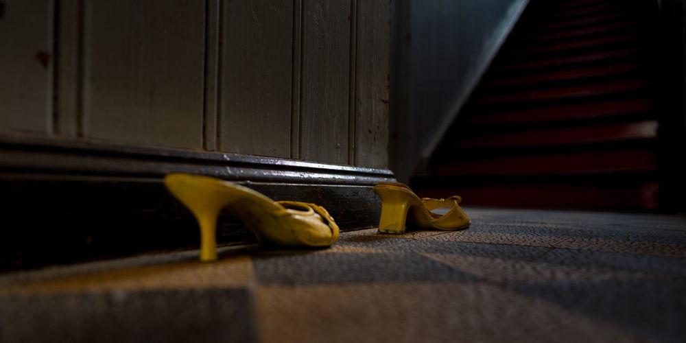 Close-up of yellow representation on wooden door