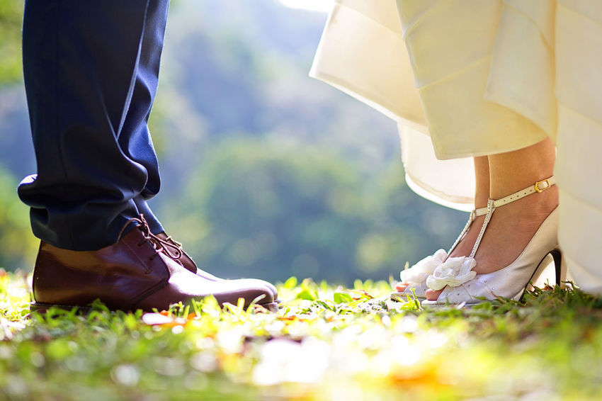 Lovely couple concept with feet together Low Section Real People Human Leg Human Body Part Shoe Selective Focus Wedding Body Part Women Adult Standing Day Newlywed Bride Two People People Plant Lifestyles Bridegroom Nature Couple - Relationship Human Foot Outdoors Wedding Ceremony Human Limb Human Connection