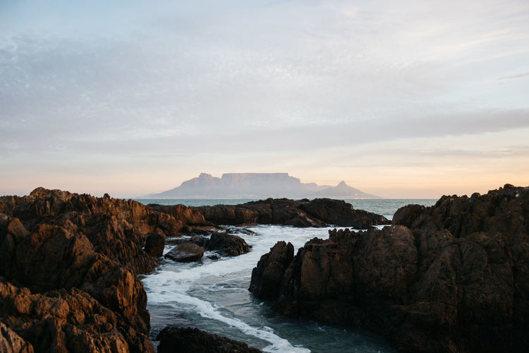 Waterway to Table Mountain. Wallpaper Travel Destinations Table Mountain Table Sunset South Africa Sky Sea Popular Photos Outdoors Ocean No People Nature Mountain Landscape Jonnynichayes Hello World Clouds Check This Out Cape Town Minimal Beauty In Nature Beach Blue My Year My View