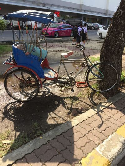 Bicycle parked on footpath in city