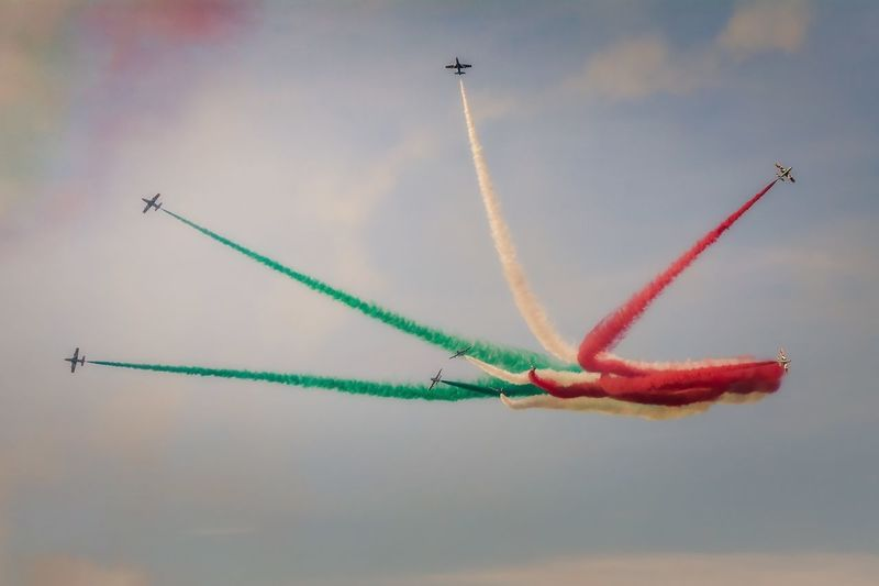 Low Angle View Of Colorful Airshow Against Sky
