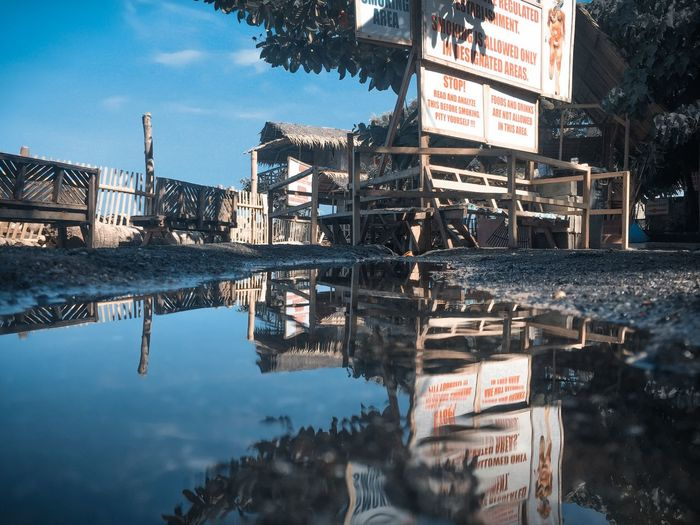 Reflection of buildings on lake against sky