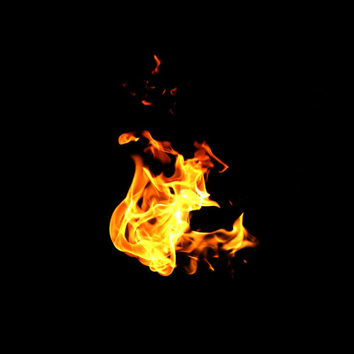 Close-up of bonfire against black background