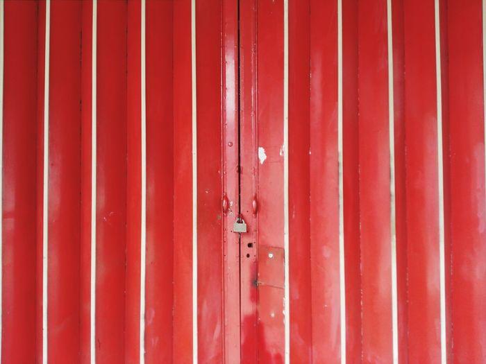 Full frame shot of closed red door