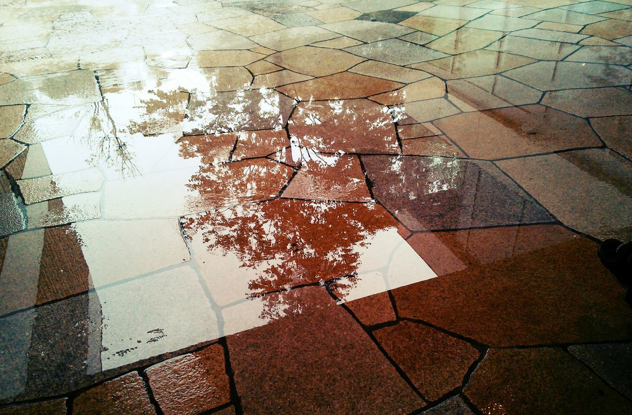High angle view of rain water with reflection on porch floor