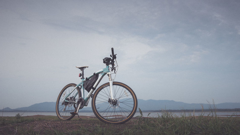 Mountain bike beside the lake Beside Bicycle Cycle Day Lake Land Vehicle Mode Of Transport Mountain Bike Nature No People Non-urban Scene Outdoors Parked Parking Remote Scenics Sky Sport Stationary Tranquil Scene Tranquility Transportation Water Waterfront Wheel