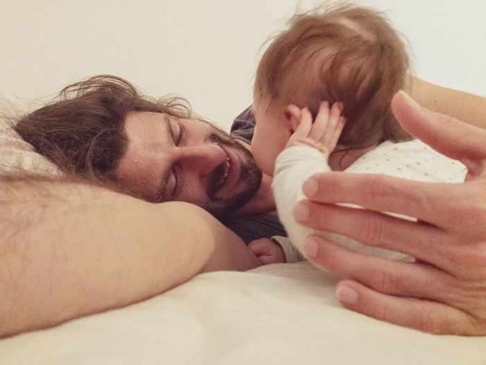 father and baby waking up in the morning Morning Waking Up Daddy Parenthood Cuddling Fatherhood Moments Togetherness Two People Love Positive Emotion Bonding Child Young Childhood Bed Baby Real People Emotion Family Moments Of Happiness