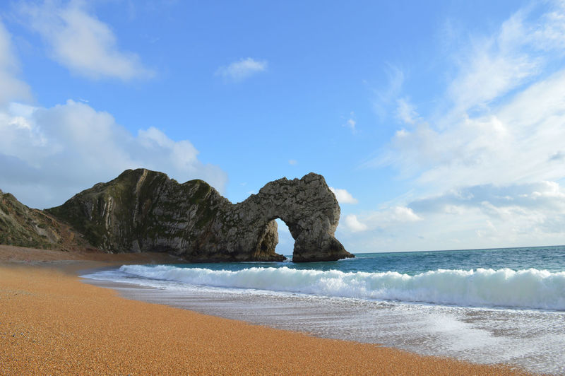 Waves reaching on shore at durdle door