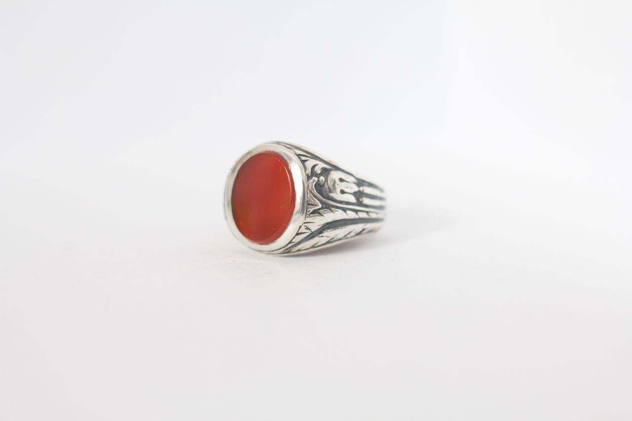 Close Up Of Gemstone On Ring Over White Background