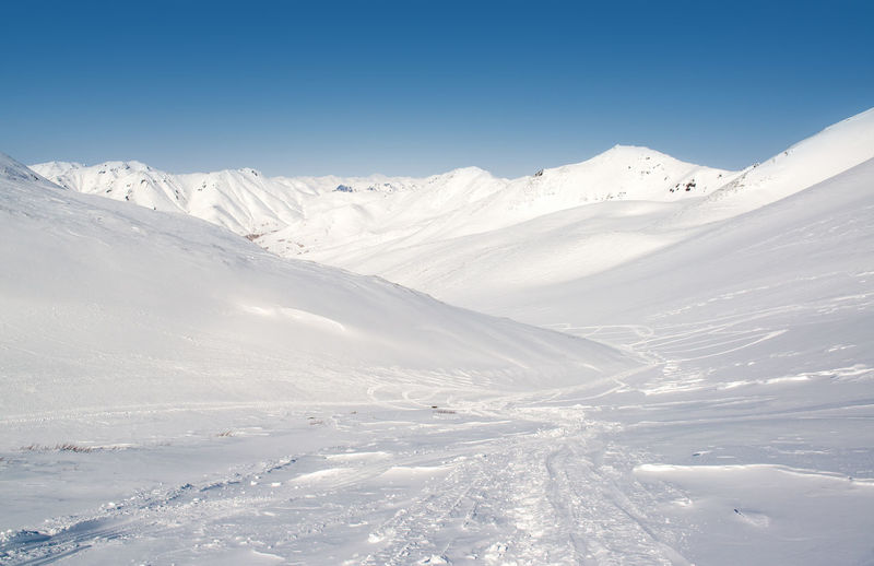 Pinachevsky pass, route through a ridge in Kamchatka. Snowy mountains. Far East, Russia Beauty In Nature Cold Far East Frozen Nature Ice Kamchatka Kamchatka Krai Kamchatka Peninsula Landscape Mountain Mountain Pass Mountain Peak Nature Nobody Petropavlovsk-Kamchatskiy Pinachevsky Pass Russia Sky Snow Snowbanks Snowdrifts Snowy Snowy Mountains Sunny Day Winter