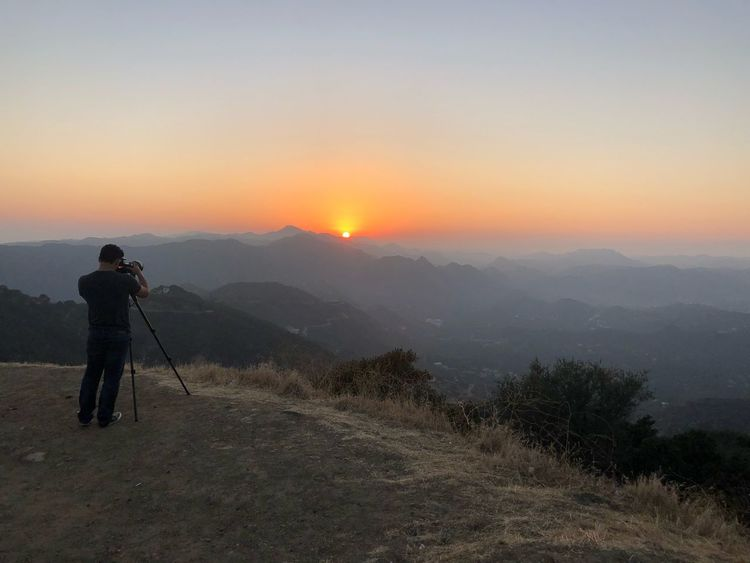 Sky Beauty In Nature Scenics - Nature Sunset Standing Men Real People Nature Mountain Landscape Tripod Land Tranquil Scene Orange Color