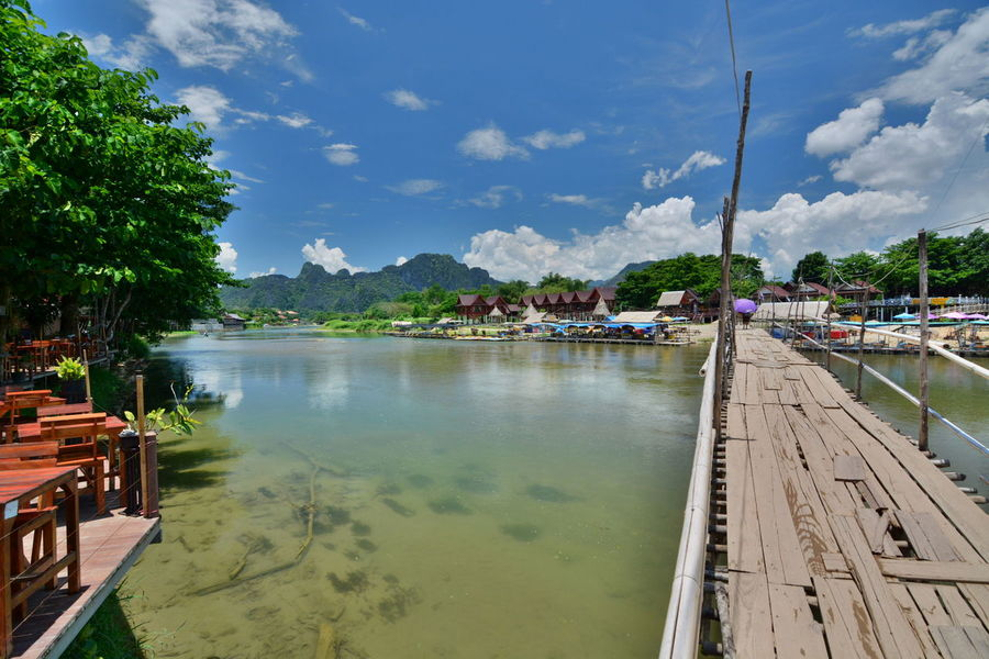 Bamboo bridge on Nam Song river. Vang Vieng. Laos Backpacker Bamboo Bamboo Bridge Beauty In Nature Cloud - Sky Laos Limestone Mountains Nam Song River No People Outdoors River Riverscape Riverside Scenics Southeastasia Travel Destinations Vang Vieng Vang Vieng, Laos Vientiane Province Water Wooden Bridge