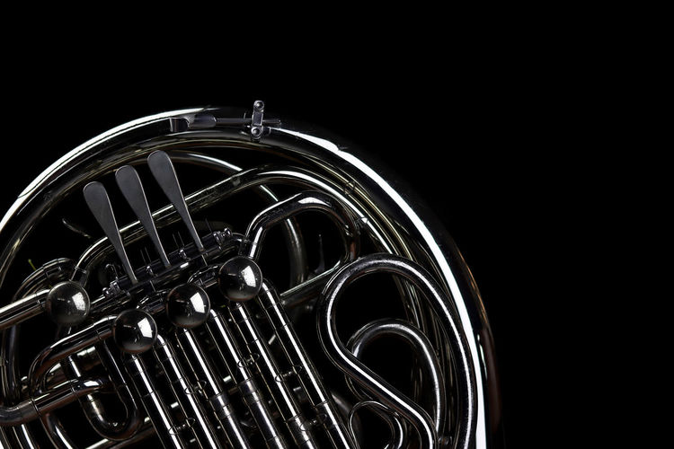 Music Instrument French Horn Black Background Studio Shot Arts Culture And Entertainment Music Metal Musical Instrument Brass Instrument  Indoors  Cut Out No People Copy Space Close-up Brass Night Wind Instrument Creativity Black Color Single Object Geometric Shape Motion Steel Clean