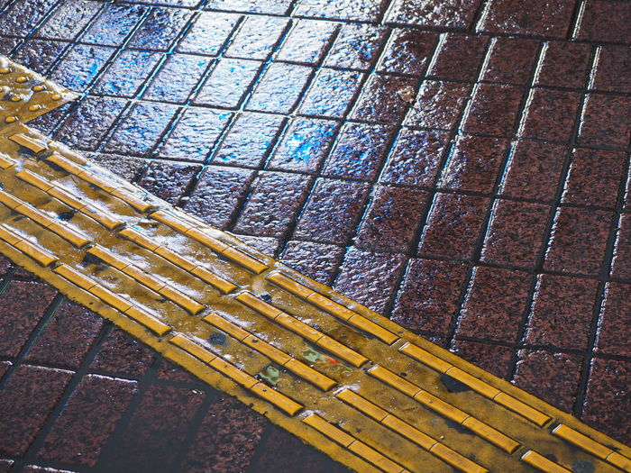Blind Close-up Day High Angle View LINE No People Outdoors Pattern Pavement Refection Wet The Graphic City