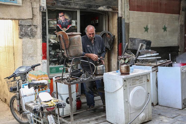 Men working in shopping cart
