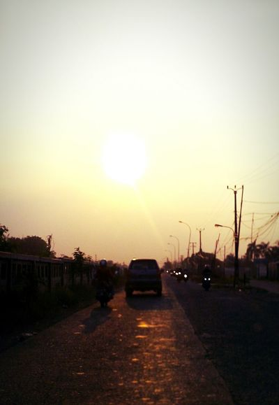 Sky Sun Sunset Outdoors Nature Road Street Tranquil Scene Full Frame Streetphotography From My Point Of View Capture The Moment Outdoor Photography Afternoon Beauty In Nature Sunbeam Reflection Sunlight Sunset_captures Dramatic Skies Bronze Orange Yellow