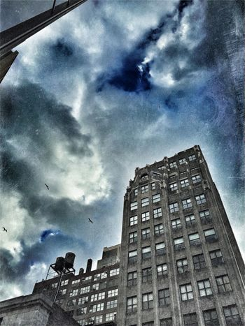 Architecture Cloud Cloud - Sky Cloudscape Cloudy Development Dramatic Sky Dusk International Landmark Looking Up Low Angle View Modern New York City No People Outdoors Overcast Sky Storm Cloud Structure Urban Watertower Weather