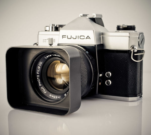 The Fujica ST701 by Adam Wesolowski Antique Camera - Photographic Equipment Close-up Communication Fujica St701 Lens - Optical Instrument Metal Old-fashioned Photography Themes Retro Styled Technology Thr Fujica ST701, Fujica, White Background