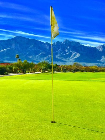 Blue Flag Green Color Grass Beauty In Nature Nature Golf Course Tranquil Scene Golf No People Scenics Sky Landscape Tranquility Green - Golf Course Golf Flag Mountain Outdoors Tree Day EyeEmNewHere Check This Out Travel Destinations