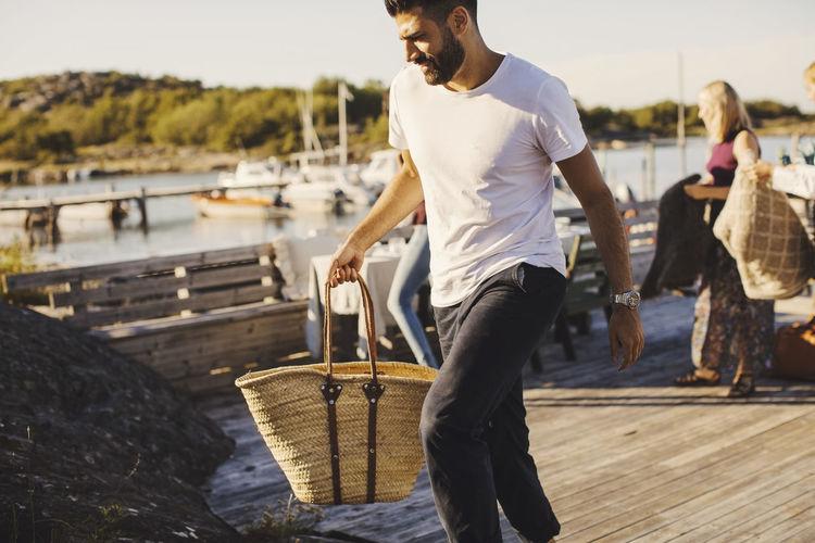 Full length of man standing on shore