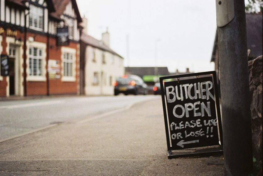 The Butcher is sending a clear message to the locals Architecture Building Exterior Built Structure Butcher Car Chalk Board Close-up Communication Focus On Foreground Local Outdoors Pub Road Road Sign Sandwich Board Street Text Your Ticket To Europe Stories From The City #urbanana: The Urban Playground