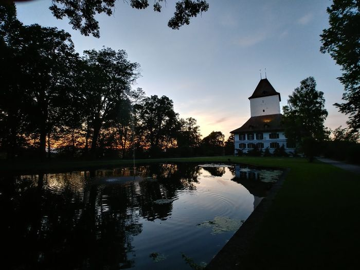 Reflection Water House Lake Architecture Building Exterior Outdoors Built Structure Tree Vacations Sky Night No People Tree Area Nature Politics And Government