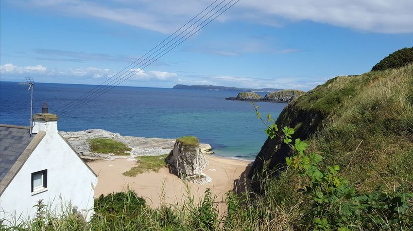 Nothern Ireland  Ulster Cottage Green Green Grass Blue Sky Beauty In Nature Tranquil Scene No People Ballintoy Water Sea Beach Tree Sky Horizon Over Water Cloud - Sky Landscape