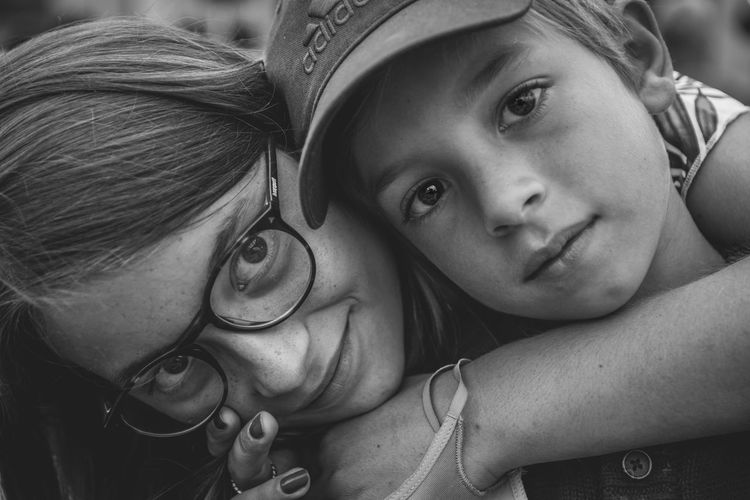 Close-up portrait of mother with daughter