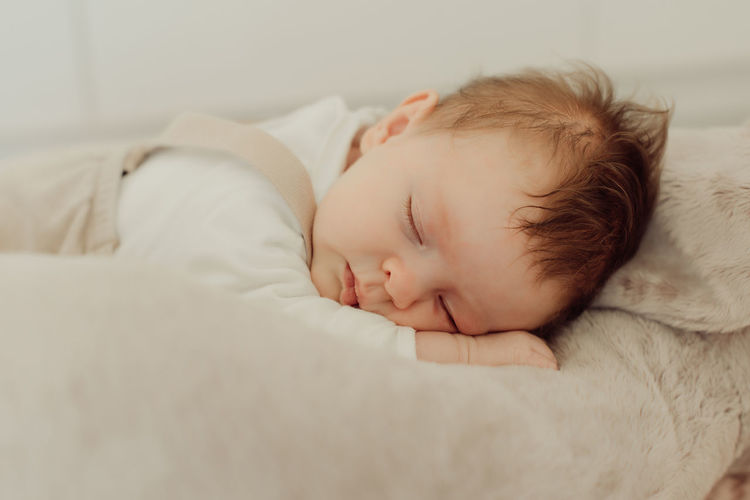 Portrait of a newborn baby slepping Baby Childhood Babyhood Lying Down Sleeping Relaxation Innocence Child Natural Light Soft