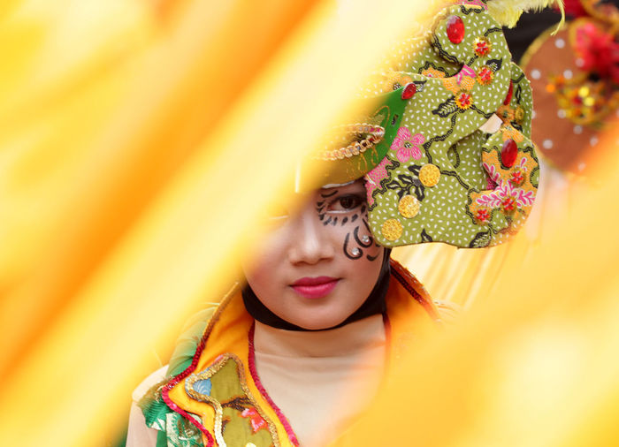Close-up of young woman wearing costume
