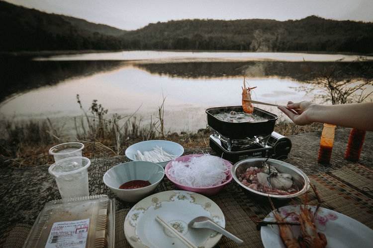 High angle view of person preparing food in lake
