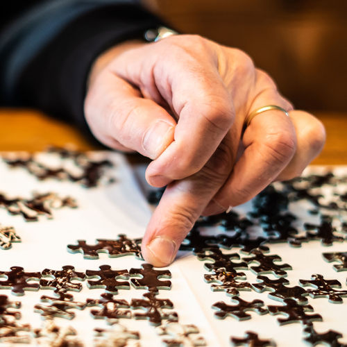 Human Hand Hand Human Body Part One Person Indoors  Leisure Activity Table Real People Leisure Games Selective Focus Body Part Unrecognizable Person Close-up Lifestyles Jigsaw Piece Finger Puzzle  Human Finger Jigsaw Puzzle Human Limb Puzzle  Puzzle Pieces