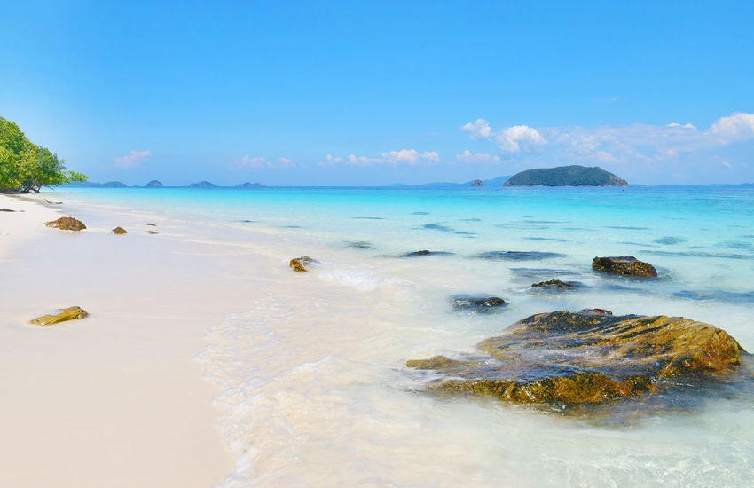 Tropical paradise beach of beautiful Nyaung Oo Phee island on sunny day in Myanmar Beach Beautiful Island Vacation Nyaung Oo Phee Island View Andaman Sea Bay Beauty In Nature Day Myanmar Nature No People Outdoors Scenics Sea Seascape Sky Tranquil Scene Tranquility Tropical Water Waves, Ocean, Nature