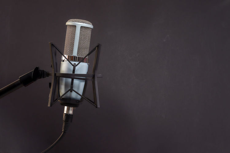 Microphone on back background No People Copy Space Architecture Indoors  Wall - Building Feature Metal Technology Built Structure Absence Nature Lighting Equipment Single Object Protection White Color Studio Shot Close-up Connection Night Still Life Electric Lamp