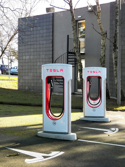 New equipment available for use in province of France Red And White Station Tesla Energy Station Energy Supply Parking Asphalt Architecture