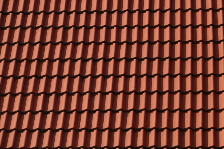 Full frame shot of roof tiles on sunny day