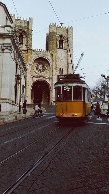 Follow the tram City Lisbon - Portugal Lissabon, Tram Church Cathedral Sé De Lisboa Travel Day History Outdoors Travel Destinations Architecture Built Structure Transportation Public Transportation