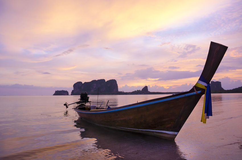 Lovely local Fisher village of Thai Muslim at Mot Tanoi Beach, Trang Province, Thailand Magic Hour Mot Tanoi Beach Thailand Trang Province Exotic Place Fishing Boat Nautical Vessel No People Outdoors Reflection Sea Sky Sunset Water Waterfront