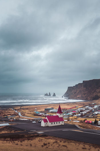 Iceland seems to have most of their churches right next to the beach. I love it!! Church Iceland Beach Beauty In Nature Cloud - Sky Day Horizon Horizon Over Water Icelandic Horse Land Mode Of Transportation Nature Nautical Vessel No People Outdoors Overcast Sand Scenics Scenics - Nature Sea Sky Transportation Travel Destinations Vik Water