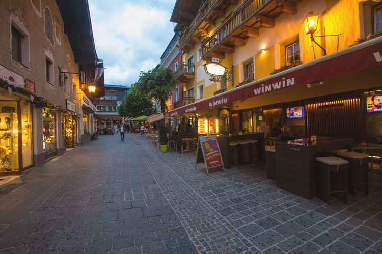 Street in Zell Am See town in Austria in the evening Austria Travel Architecture Built Structure Dusk Illuminated Night Outdoors Street Tourism Town Town Square Zell Am See