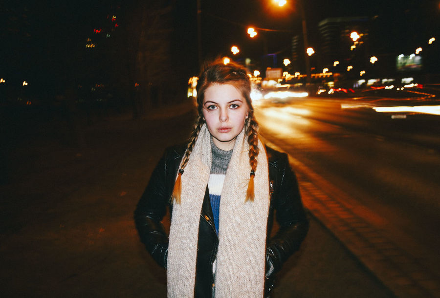 Blonde Girl Casual Clothing Front View Illuminated Leisure Activity Lifestyles Long Scarf Night Night Lights Night Photography Outdoors Portrait Pretty Girl Road Serious Face