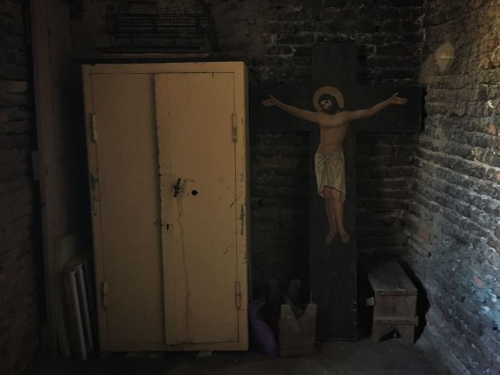 A wooden cross rests next to a closet in the back room of the church at Uplistsikhe, Georgia Traveling Caucasus Georgia Church Cross