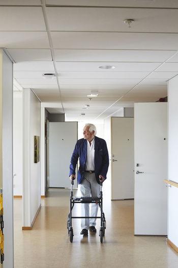 Portrait of man in corridor of building