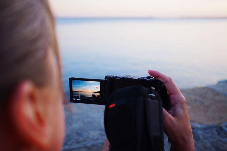 Cropped image of man holding camera